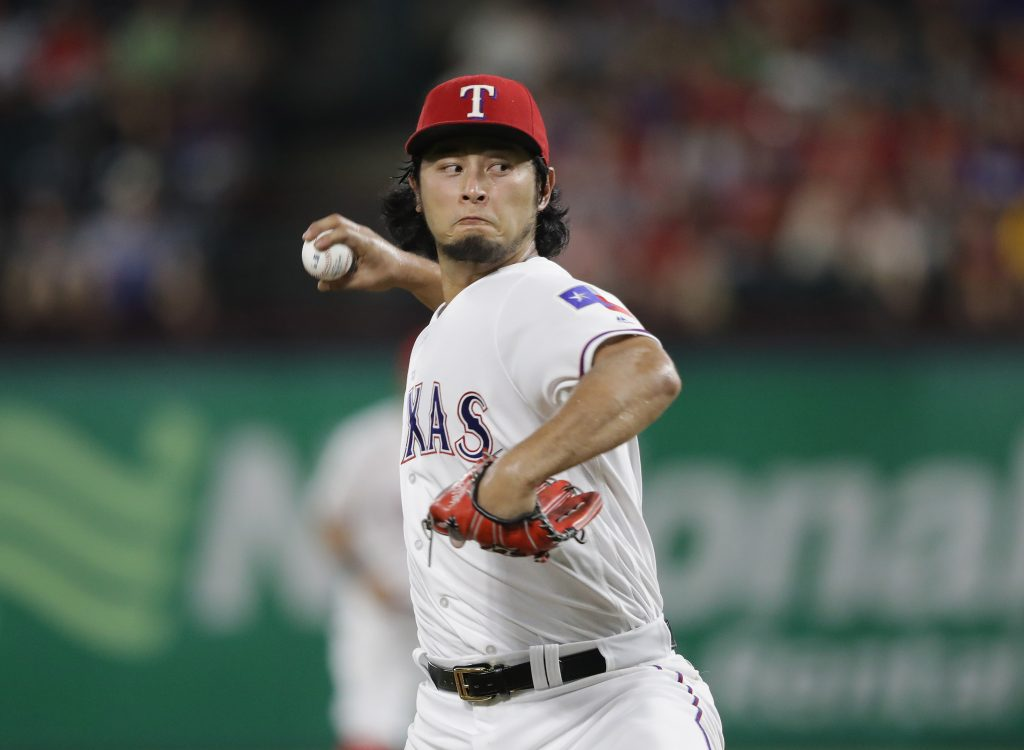 ARLINGTON, TX - AUGUST 29:  Yu Darvish #11 of the Texas Rangers throws against the Seattle Mariners in the fifth inning at Globe Life Park in Arlington on August 29, 2016 in Arlington, Texas.  (Photo by Ronald Martinez/Getty Images)